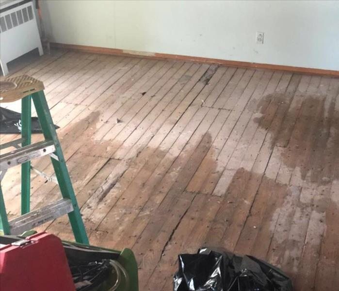 wet rough floorboards in a room